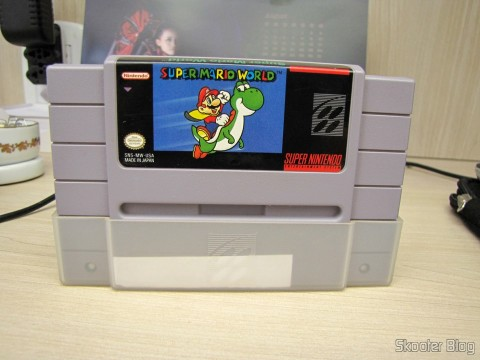 Super Mario World cartridge that comes with the Super Nintendo