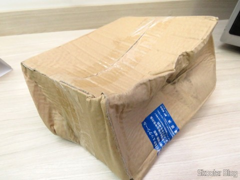 Package with the Sony Playstation SCPH-1160 AV Adapter, crumpled by the Post Office and the IRS