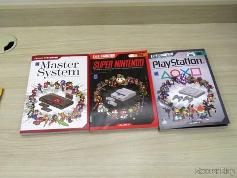 Os três primeiros volumes da coleção Dossiê OLD!Gamer: Master System, Super Nintendo e PlayStation