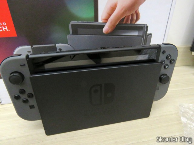 Nintendo Switch with Joy-Con and in the dock.