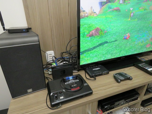 Nintendo Switch, com dock instalado no rack da sala.