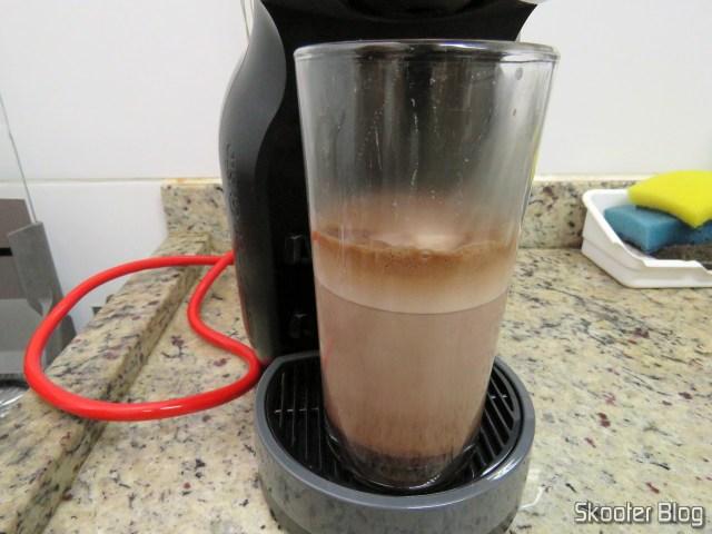 Preparing a Chococino on Coffee Nescafé Dolce Gusto Black Mini Me.