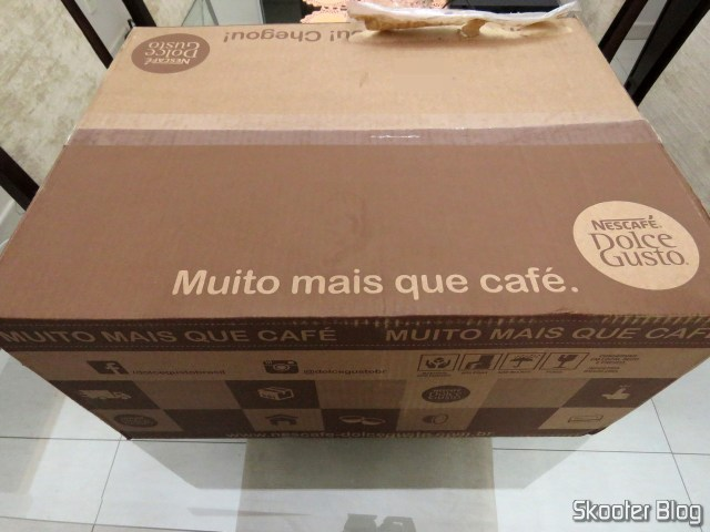 Box of Nescafe Dolce Gusto with the coffee maker and the six boxes of capsules.