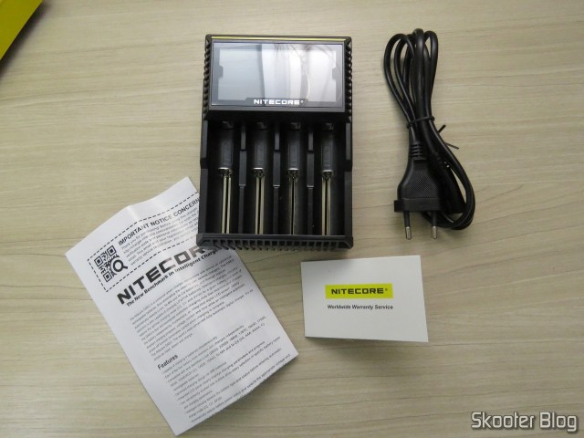 Nitecore Digicharger battery charger D4EU, and accessories.