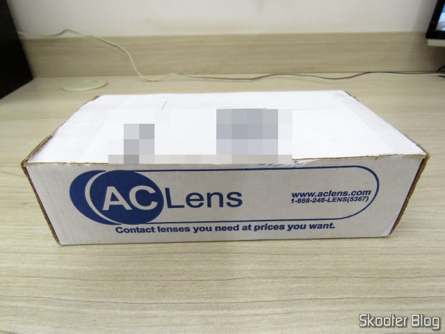 The box AC Lens with Aspheric Contact lenses from Coopervision Frequency 55 Aspheric + Contact lens case.