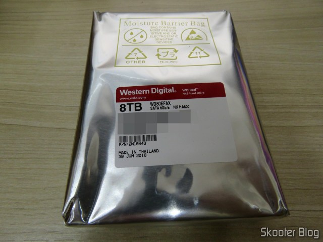 "Western Digital 8 TB WD Drives Red Bare in the Hard Disk Drive - 5400 RPM Class SATA 6 GB/S 256 MB Cache 3.5"" (WD80EFAX), on its packaging."