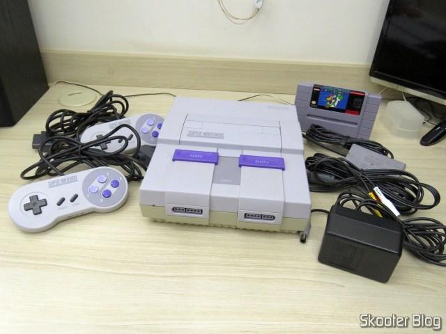 Super Nintendo Original NTSC PCB SHVC-CPU-01 CPU/PPU1/PPU2 1/1/1, and accessories.