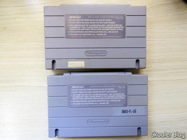 Os dois cartuchos Super Mario World, ambos originais.