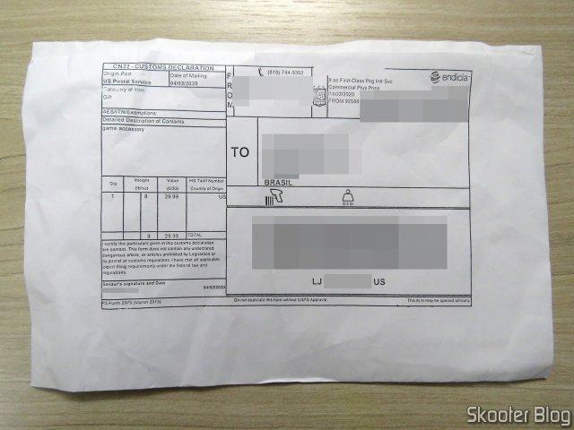 Pacote da Envios Diretos com o Controlador de Mega Drive Retro-Bit Sem Fio Arcade Pad 2.4 GHz.