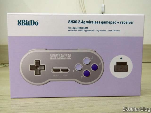 2º 8BitDo SN30 2.4G Wireless Controller for Super Nintendo (SNES) Original, on its packaging.