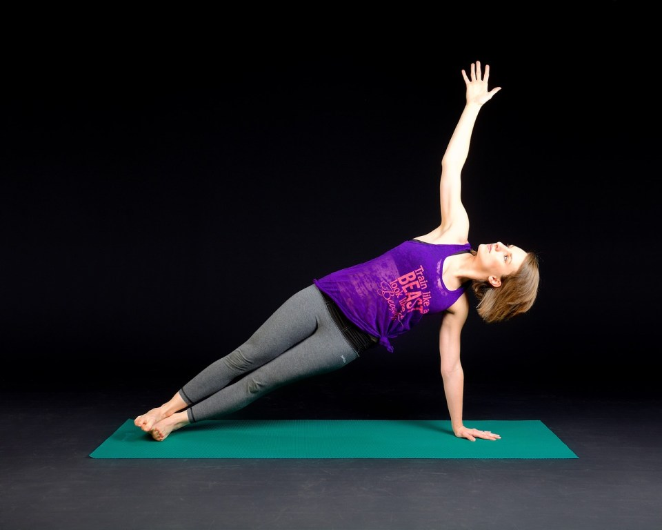 A sexy woman doing side plank
