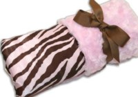 Pink pillow wrapped with a ribbon