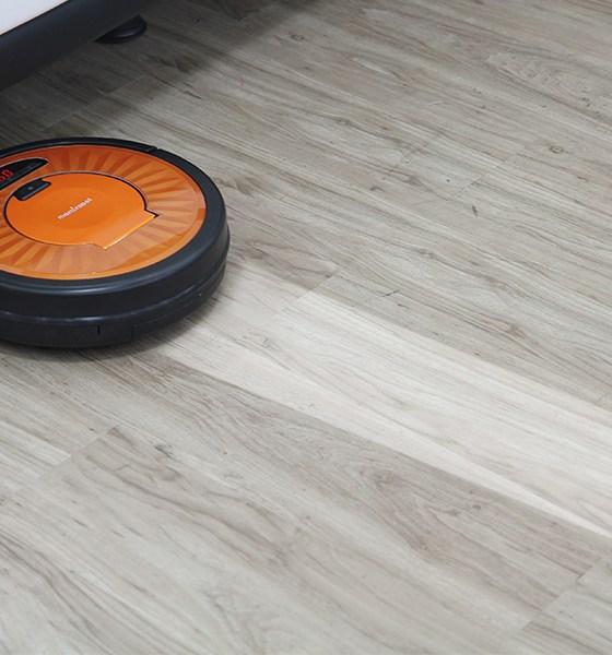 a robovac vacuuming the floor