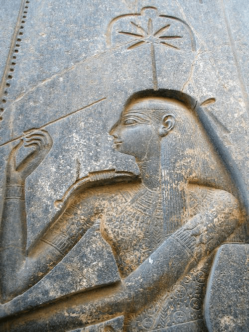 Egyptian goddess Seshat with a weed leaf above his head