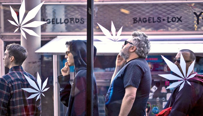 people are waiting in front of the cannabis dispensary