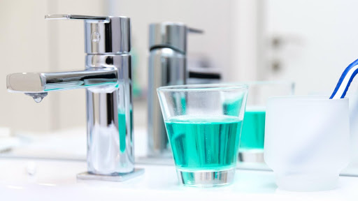 mouth wash close to the water tap