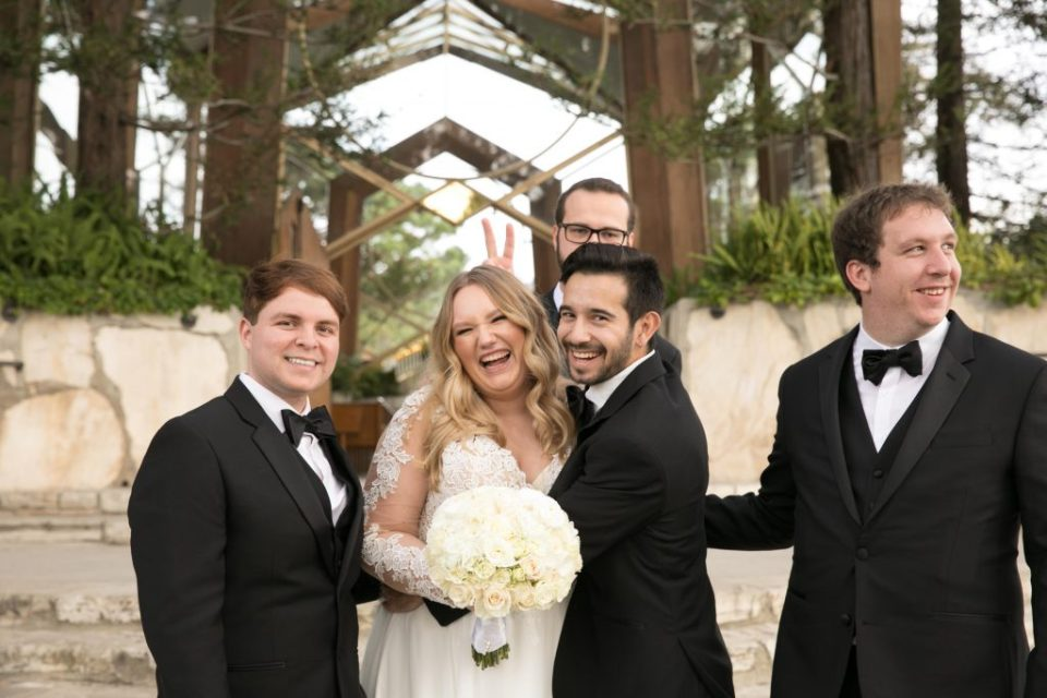 bride and groomsmen act silly bunny ears