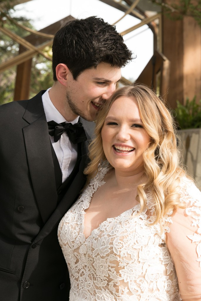 bride getting a kiss on top of head from groom california church