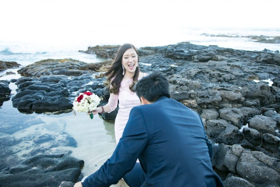 bride laughs ocean rocks