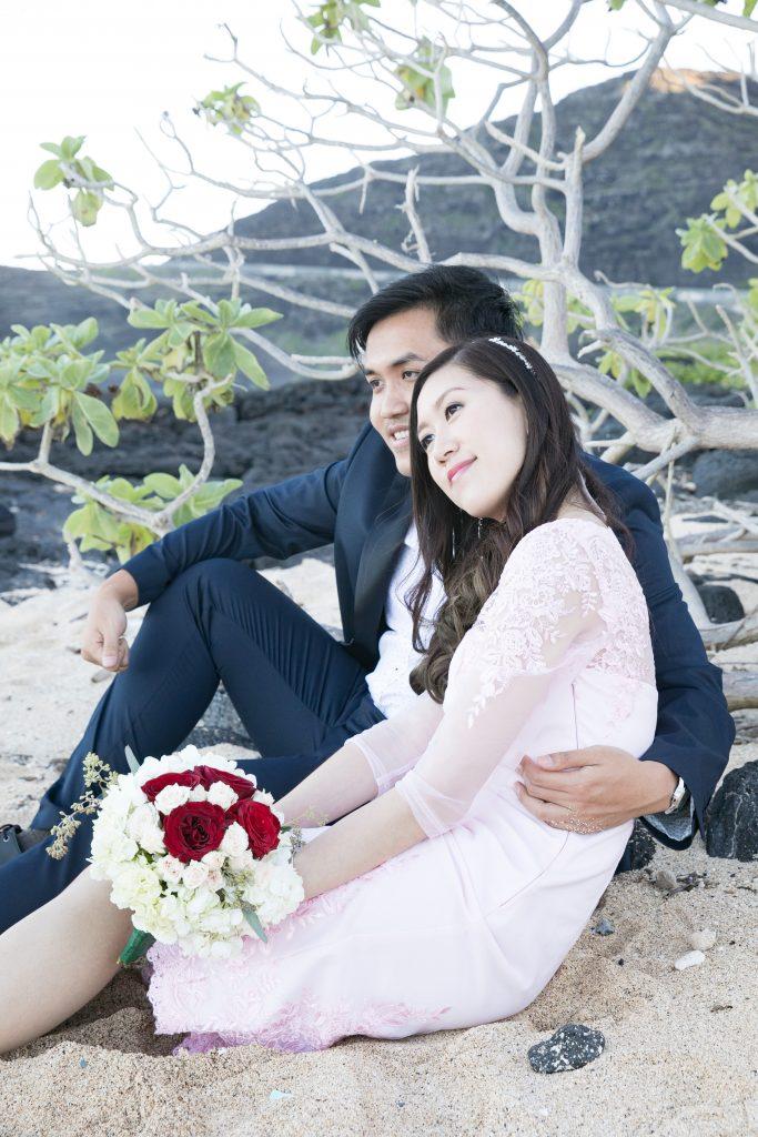 bride and groom look at ocean