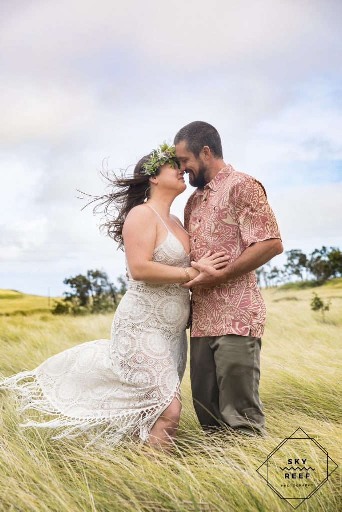 Anna's ranch wedding couple kiss in field