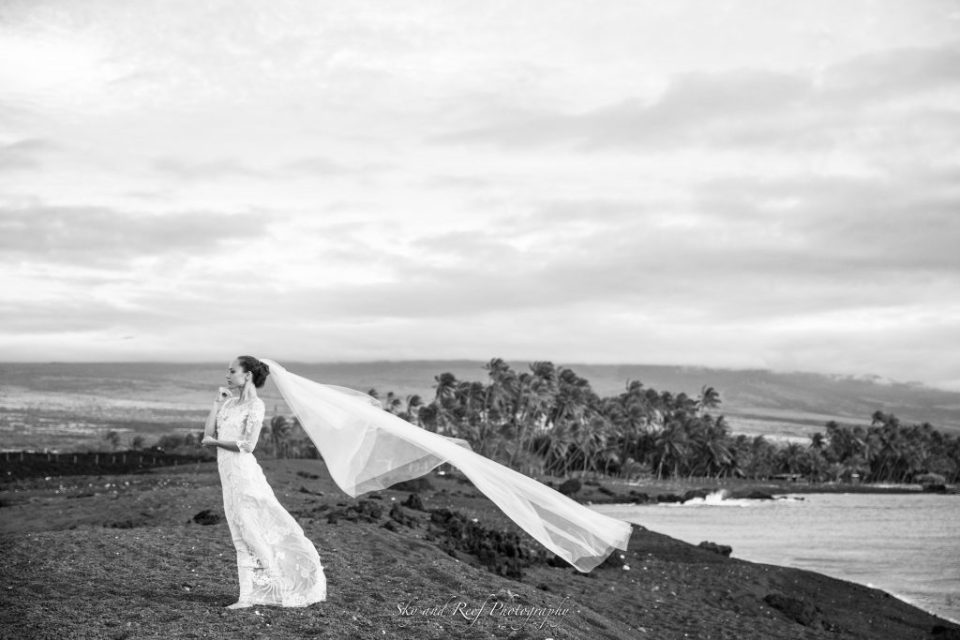 black and white dramatic shot on beach bride