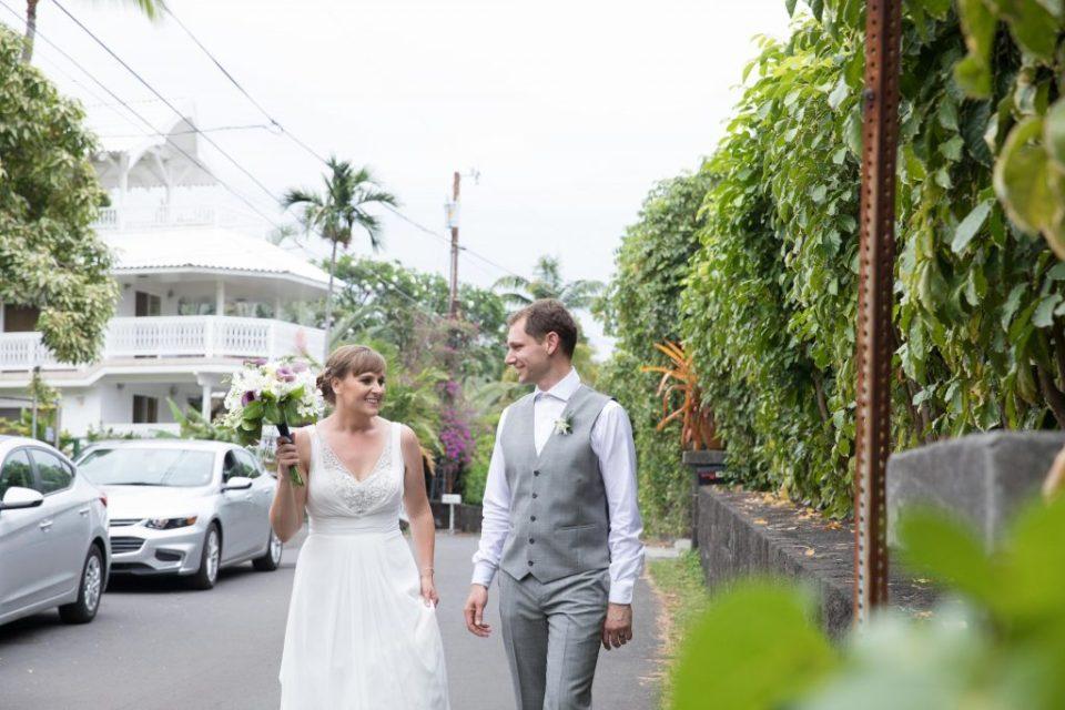 couple walk the neighborhood of Kealakekua Bay Wedding Venue