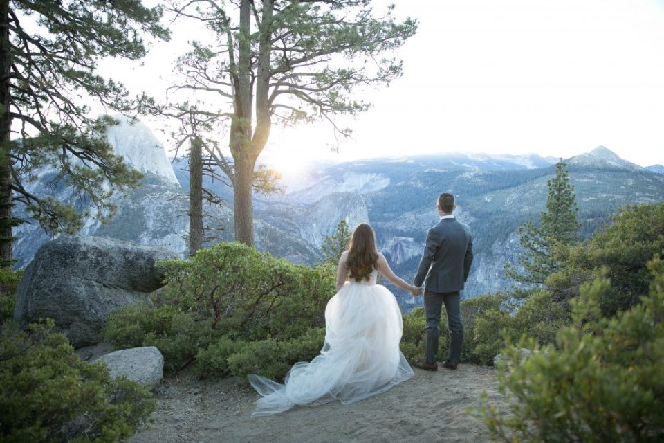 couple check out the Yosemite view