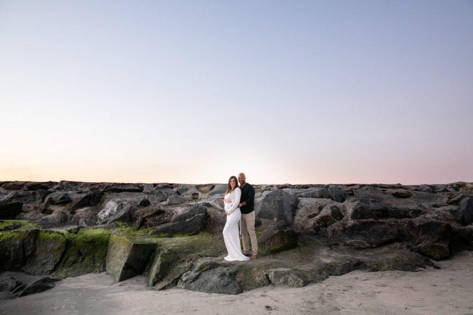 scenic of couple on beach maternity