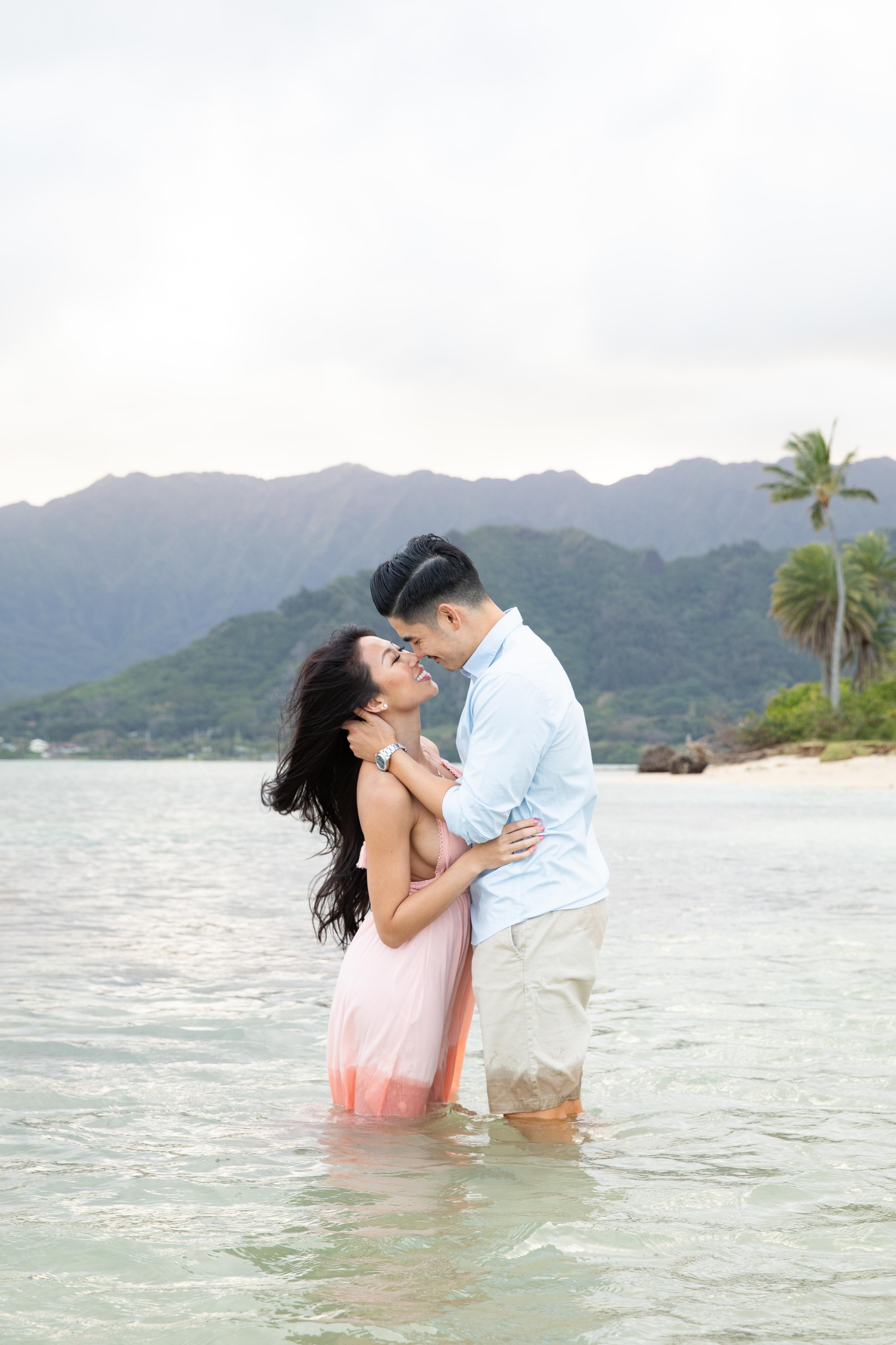 couple kiss at Kualoa beach