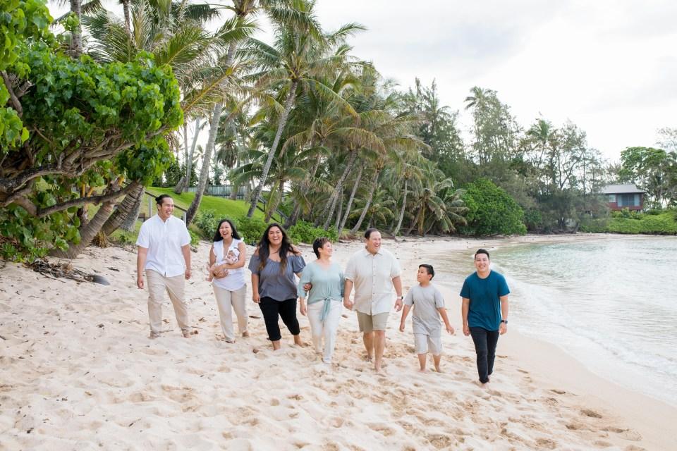 family walks on beach