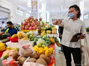 Jamil Picking Fruit at Mercado Santiago