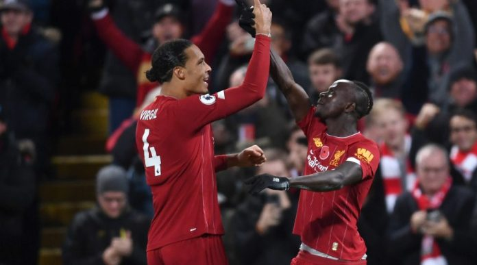 LIVERPOOL, ENGLAND - NOVEMBER 10: Sadio Mane of Liverpool celebrates after scoring his team's third goal with teammate Virgil van Dijk during the Premier League match between Liverpool FC and Manchester City at Anfield on November 10, 2019 in Liverpool, United Kingdom. (Photo by Laurence Griffiths / Getty Images)