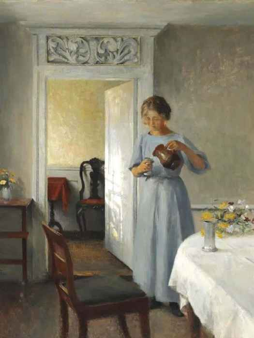 Peter Ilsted (Danish, 1861 - 1933) Young girl in a light blue dress arranges flowers, 1908