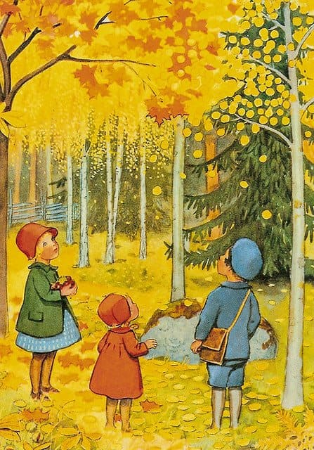 Three children in a forest look up at the yellow leaves on the trees in wonder.