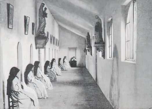 Where Women Never Speak A Sœur de Marie is reading to them as they sit at their cell doors