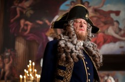 """""""PIRATES OF THE CARIBBEAN: ON STRANGER TIDES"""" Now a privateer in service to the British crown, Hector Barbossa (GEOFFREY RUSH) is now incongruously arrayed in a fine naval uniform and adorned in a powdered wig as befits his new rank."""