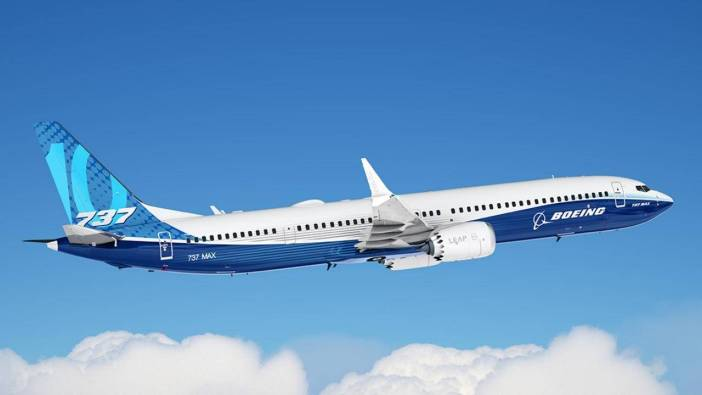 A Boeing plane flying in a beautiful blue sky