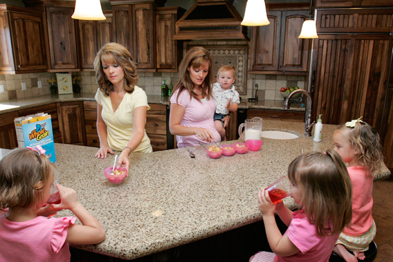 Sister-wives Valerie (Left) and Vicki serve breakfast to their children in their polygamous house in Herriman, Utah, in this file photo from May 30, 2007.  Polygamy, once hidden in the shadows of Utah and Arizona, is breaking into the open as fundamentalist Mormons push to decriminalize it on religious grounds, while at the same time stamping out abuses such as forced marriages of underage brides.