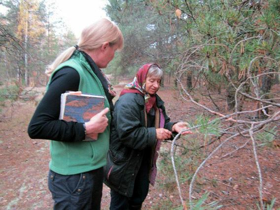 "Author Mary Mycio (L) author of ""Wormwood Forest: A Natural History of Chernobyl"" with Valentina, 65, pointing out the healing herbs in a special spot of the forest."