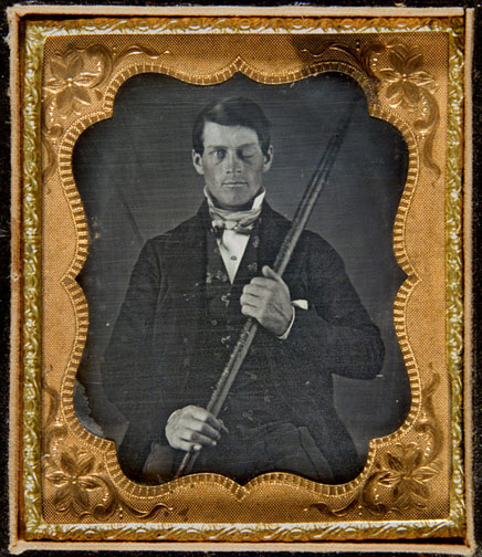 Cased-daguerreotype portrait of Phineas P. Gage holding the tamping iron which injured him.
