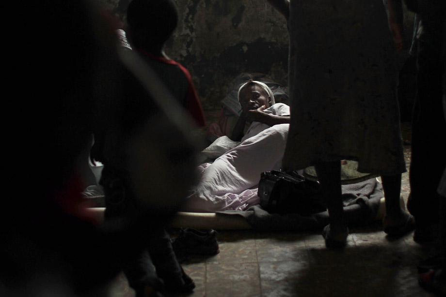 A family lives in a room on the grounds of an abandoned hospital where they and hundreds of others had been evacuated from the Corail-Cesselesse relocation camp, due to Hurricane Tomas Nov. 5, 2010, in Port-au-Prince, Haiti. The storm, which caused some flooding and heavy rains, largely spared Haiti.