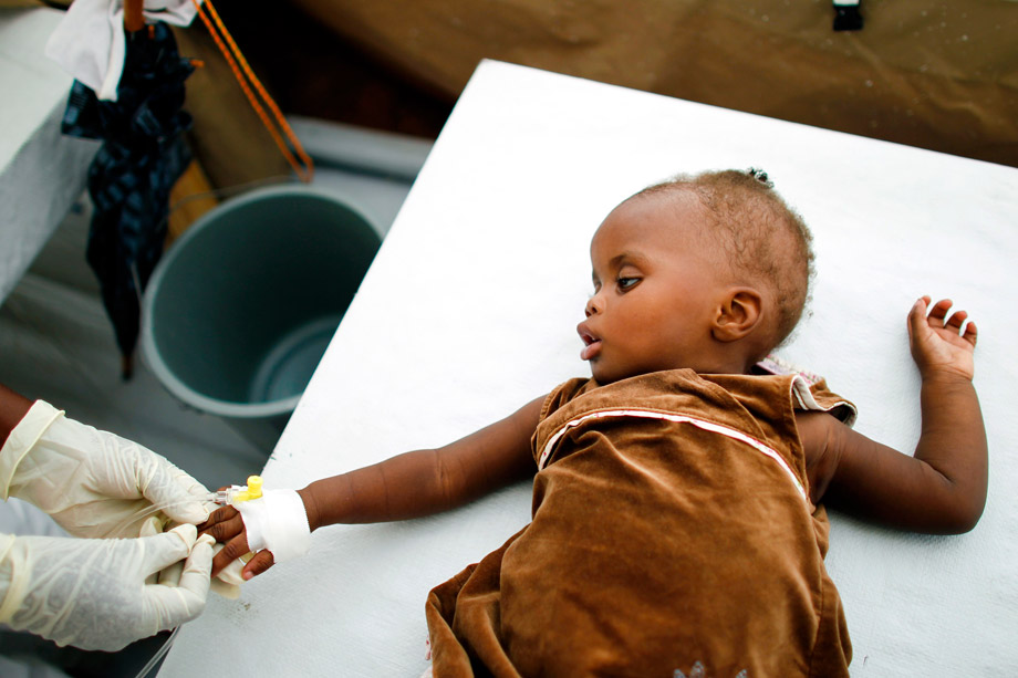 A Haitian girl receives an intravenous drip at a cholera treatment center of Doctors Without Borders in Port-au-Prince, Jan. 10, 2011.
