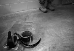 "This image reviewed by the US military shows the floor shackles within the solitary recreation room in Cell Block C in the ""Camp Five"" detention facility of the Joint Detention Group at the US Naval Station in Guantanamo Bay, Cuba, January 19, 2012."