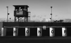"A U.S. military guard tower stands on the perimeter of a detainee camp at the U.S. detention center for ""enemy combatants"" on September 16, 2010 in Guantanamo Bay, Cuba."