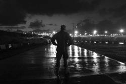 A U.S. Navy sailor looks towards the Guantanamo Bay detention center on March 30, 2010 in Guantanamo Bay, Cuba.