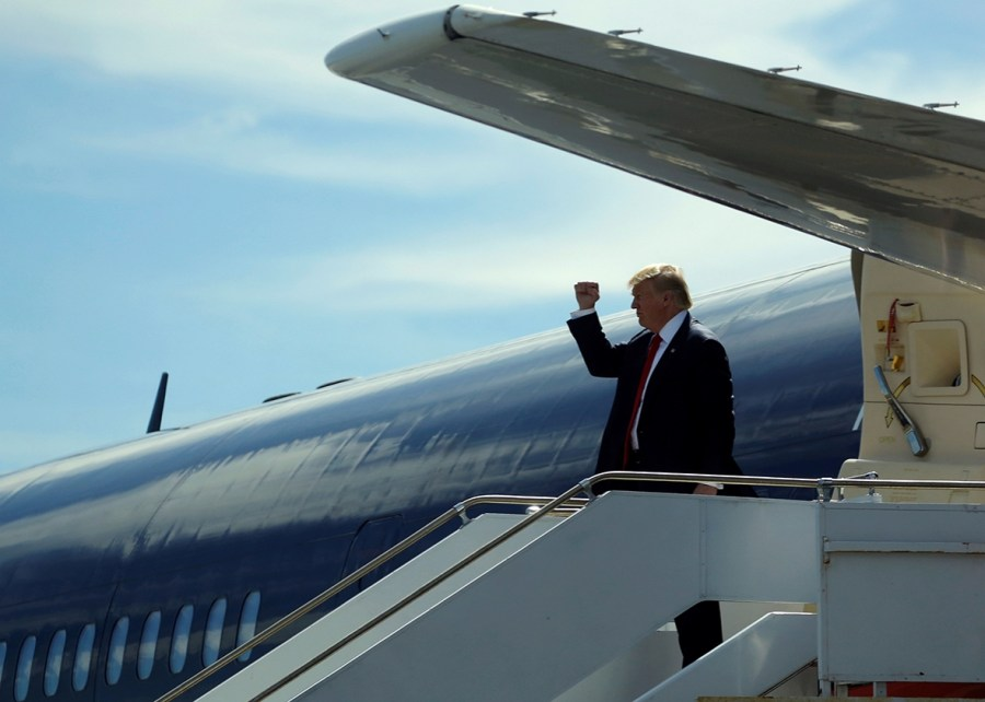 U.S. presidential nominee Donald Trump gives a fist-pump to the ground crew as he arrives on his plane in St. Augustine, Florida, U.S. October 24, 2016.