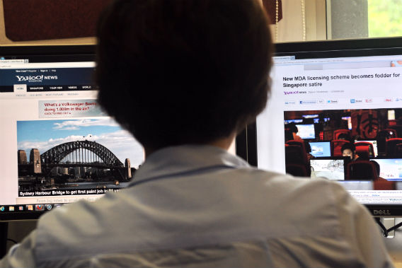 A person browses through media websites on a computer on May 30, 2013.