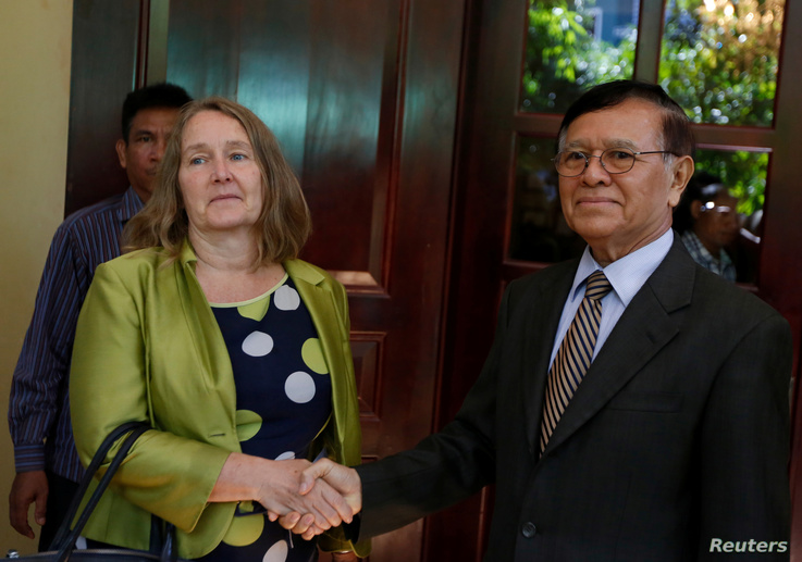 Leader of the Cambodia National Rescue Party (CNRP) Kem Sokha shakes hands with British Ambassador to Cambodia Tina Redshaw at…