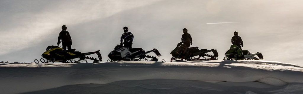 Snowmobilers in action